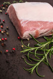 Rosemary and raw pork loin Royalty Free Stock Images