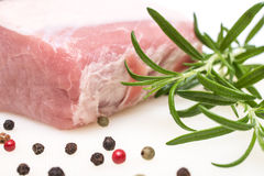 Rosemary with raw saddle of pork Stock Photography
