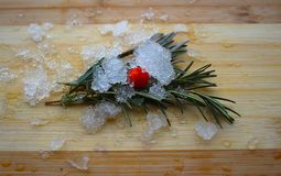 Rosemary, red berry and lavender on a wooden board stock image