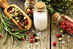 Rosemary, salt and different kinds of pepper Stock Photo