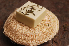 Rosemary Soap. On a natural scrub pad Royalty Free Stock Photography