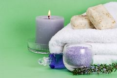 Rosemary spa set. Spa set with rosemary with copyspace over green paper background best suited for relaxing and health commercials stock photography