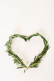 Rosemary sprigs heart. Shot of rosemary sprigs heart Stock Photo