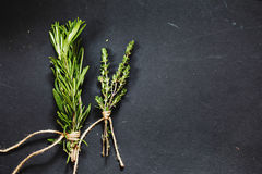 Rosemary and thyme bounds on a dark grey board Royalty Free Stock Images