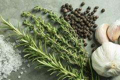 Rosemary, Thyme, Garlic, Salt and Pepper on Green Slate Backgrou Stock Photography