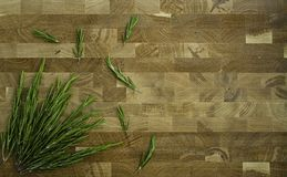 Rosemary on a wooden background stock photography