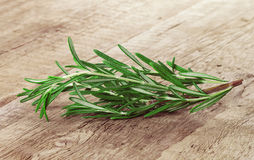 Rosemary on a wooden background Stock Images