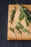 Rosemary on wooden background Royalty Free Stock Photos
