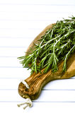 Rosemary on the wooden board Royalty Free Stock Photos