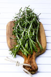 Rosemary on the wooden board Royalty Free Stock Images