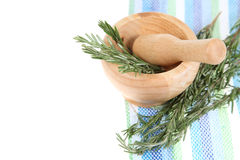 Rosemary in a wooden pounder Stock Image