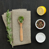 Rosemary with wooden spoon and spices Stock Images