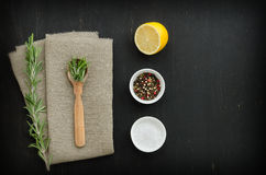 Rosemary with wooden spoon and spices Stock Image