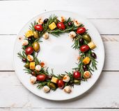 Rosemary wreath christmas appetizer with cheese and olives royalty free stock image