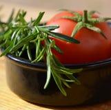 Rosemary y tomate Imágenes de archivo libres de regalías