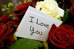 Rosen mit ich liebe dich Karte Lizenzfreie Stockbilder