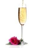 Rosen-und Champagnerwein getrennt lizenzfreie stockfotografie