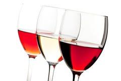Rosen-, weißer und Rotwein stockfotos