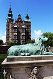 Rosenborg Castle in Copenhagen, Denmark. With a lion in front royalty free stock image