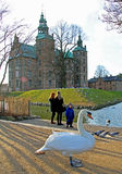 Rosenborg Castle in Copenhagen. Swan and tourists at Rosenborg Castle in Copenhagen, on a sunny day Royalty Free Stock Photos