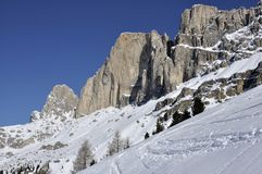 Rosengarten crags, dolomites. Scenic landscape of famous mountain  in winter, shot in bright light Stock Photos