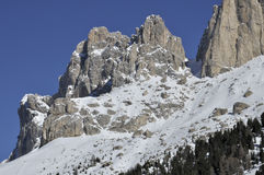 Rosengarten peak, dolomites. Scenic landscape of mountain peak  in winter, shot in bright light Stock Images