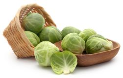 Rosenkohl or Brussels sprouts. In a basket isolated over white background Stock Images