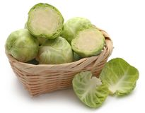 Rosenkohl or Brussels sprouts. In a basket isolated over white background Royalty Free Stock Photos