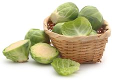 Rosenkohl or Brussels sprouts. In a basket isolated over white background Royalty Free Stock Photo