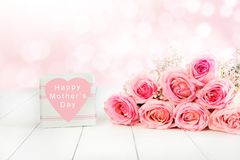 Rose bouquet in pink for Mother`s Day with gift box stock photos