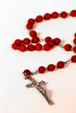 Rosery. Red Rosary on a white background Stock Image