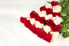 Roses. The red beautiful roses bouquet, lays on white to fur, close. Profile Adobe RGB (1998 Royalty Free Stock Photos
