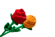 Velvet roses isolated on white background. Red and yellow fabric roses on white background Stock Image