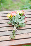 Roses. A bouquet of roses from the garden lie on a garden table Stock Images