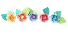 Roses. 5 origami roses decoration on a white background Stock Photo