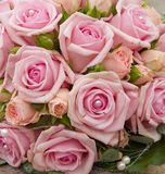 Bride bouquet with Roses.JH. Pink roses in a bride boquet.JH royalty free stock image