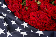 Roses on american flag. Memory Royalty Free Stock Photos