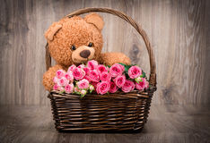 Roses And A Teddy Bear Stock Images