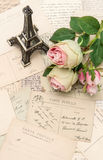 Roses, antique french postcards and souvenir royalty free stock photos