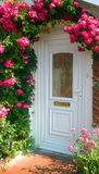 Roses around the door Royalty Free Stock Photos