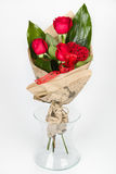 Flower bouquet arrangement lateral view. Flower arrangement bouquet composed of roses in transparent vase, lateral view, on white background royalty free stock images