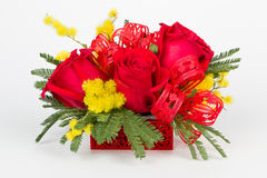 Flower bouquet arrangement in red box lateral view  Royalty Free Stock Photo