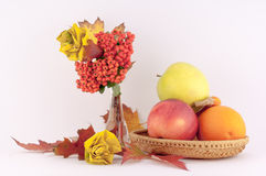 Roses from Autumn Leaves and Fruits. Beautiful decoration made from autumn leaves of roses and seasonal fruits on a white background royalty free stock photography