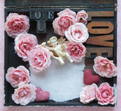 Roses avec des mots et l'ange d'amour Photo libre de droits