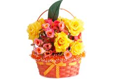 Roses in basket. Colorful fabric roses in wicker basket isolated on white background Stock Photography