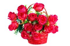 Roses in basket. Red fabric roses in wicker basket isolated on white background Stock Photography