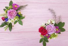 Roses beautiful bouquet decorative frame design composition festive on a pink wooden background jasmine, magnolia stock image