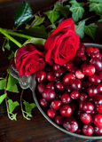 Roses and berries Royalty Free Stock Photo