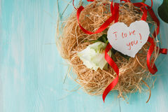 Roses in a bird nest Stock Photos