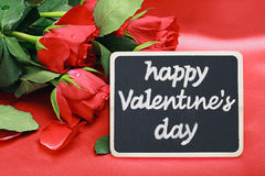Roses and a blackboard with congratulations happy valentine Royalty Free Stock Photos